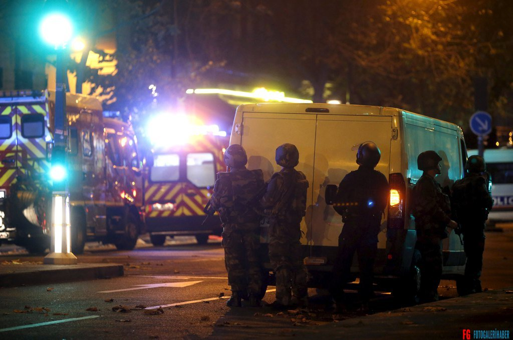 French riot police secure the area near the Bataclan concert hall following a fatal shooting at a restaurant in Paris, France, November 13, 2015. People are being held hostage at the Bataclan concert hall in central Paris after several shots were fired, French news channel BFM TV reported on Friday.  REUTERS/Christian Hartmann